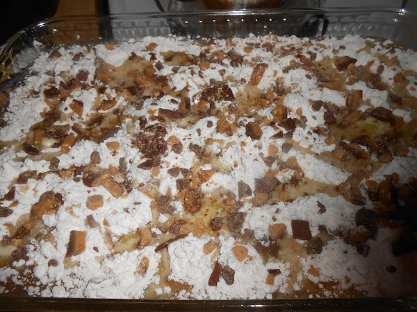 Break or chop the frozen candy bars into small pieces. Sprinkle over the cake...