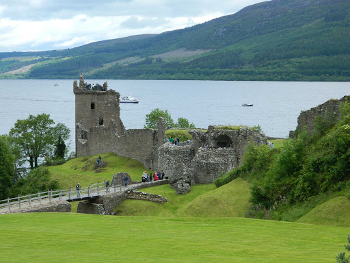 Urquhart Castle on the shore of Loch Ness. The castle is one of the largest in Scotland in area and in its day was defended by a ditch and drawbridge.
