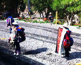 Photo: Vendors at Ollantaytambo train station selling Andean goods.