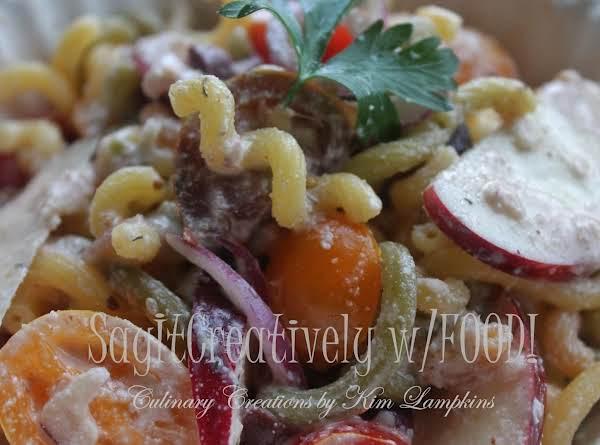 Rainbow Quinoa Pasta Salad     *spiral Quinoa Pasta, Tomatoes, Red Onion, Red Apple, Dill, Ginger, Garlic, Lemon Juice, Italian Dressing, Raw Garlic Almond Mayo