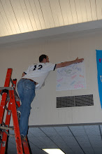 Photo: Hanging the banners in Strickland