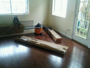 Photo: Hardwood floors over the new slab Island Park NY. New walls too.