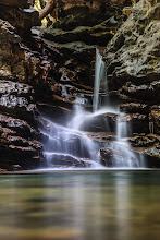 Photo: We found this little waterfall down the back of a cave in Cuba. We'd hiked about an hour to get here and were happy to see that we had the place to ourselves. That turned out to be very useful because a certain degree of contortionism was required to take photos in here. We'd have looked pretty silly to any audience!  It's not obvious from this photo but to get this I had to balance the camera between some rocks and lie on the ground with my feet against a rock wall just so I could see through the viewfinder :)  For #WaterfallWednesday, curated by +Eric Leslie