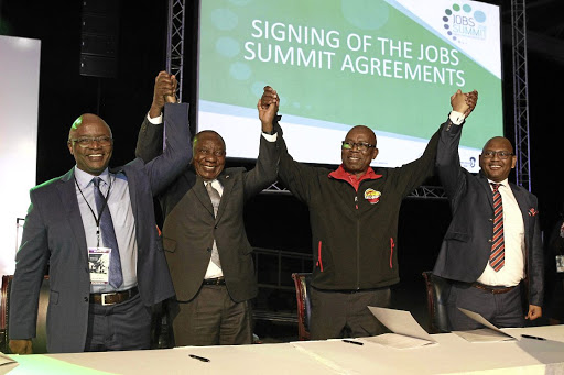 Sipho Pityana, President Cyril Ramaphosa, Bheki Ntshalintshali and Thulani Tshefuta celebrate after signing a framework agreement to create 275 000 jobs.