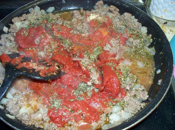 To the cooked meat mixture add the spices, tomato paste , diced tomatoes ,...