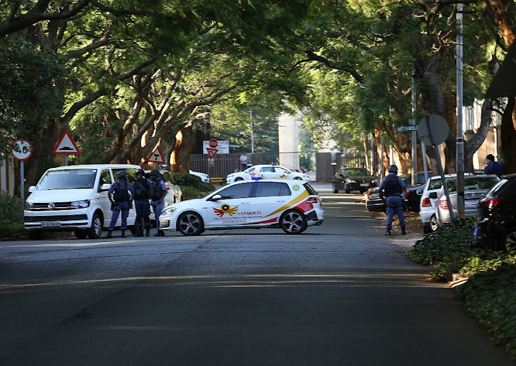 The Hawks raid the Gupta family compound in Saxonwold. Picture: ALON SKUY​