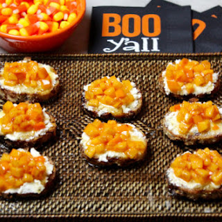 Persimmon Cranberry Goat Cheese Crostini