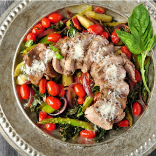 Pork over Warm Kale and Asparagus Salad