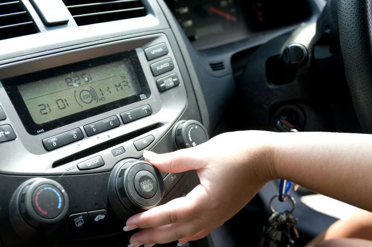 her car radio while seated