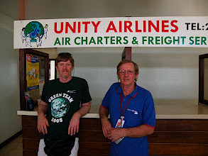 Photo: Tony and Bryn in front of Tony's office at the Airport