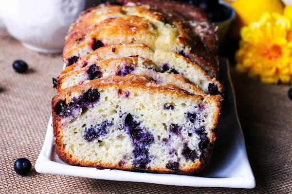 Slices Of Lemon Glazed Blueberry Tea Bread.