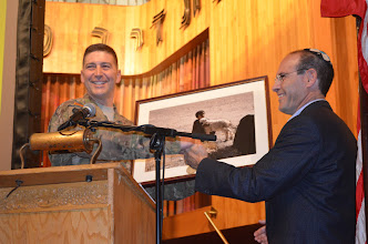 Photo: Col. Eric Alhness, Commander of the Minnesota National Guard Argibusiness Development Team presents a token of appreciation to Gil Mann, Past President of Beth El Synagogue, after premier showing of Twin Cities Public Television Documentary 'Bridging War and Hope,' at the Beth El Synagogue in St. Louis Park, Minn. on Oct. 20.