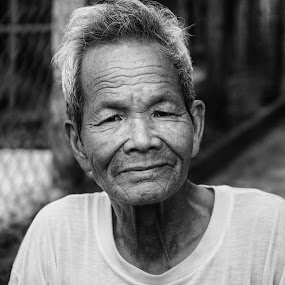 Vietnamese man in the street by Richard Ryan - Black & White Portraits & People ( black and white, male, candid, street scene, portrait,  )
