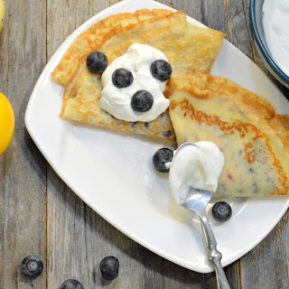 Crepes with Lemon Curd and Blueberry Sauce.