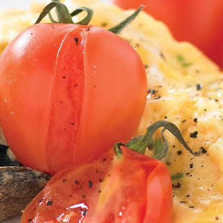 Scrambled Eggs with Tomatoes and Mushrooms.