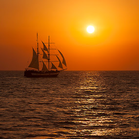 Chasing the sun by Andrei Grososiu - Transportation Boats ( mediterranean sea, fregate, sunset, sea, santorini )