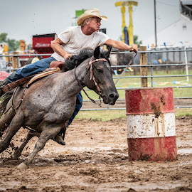 by Stephen  Barker - Sports & Fitness Rodeo/Bull Riding ( horse, barrels, determination, riding, mud )