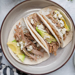 Slow Cooker Salsa Verde Pulled Pork Tacos.
