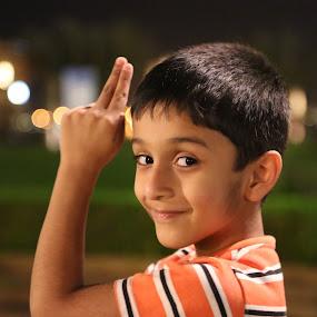 James Bond !!! by Manoj Ojha - Babies & Children Child Portraits ( water front, uae, james bond, #cutesmile, night, al majaz, #waterfront #buhairacorniche, sharjah, #uae #night #almazaz #sharjah #jamesbond #kid )
