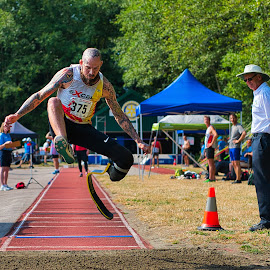 Navigating The Long Jump by Garry Dosa - Sports & Fitness Other Sports ( august, sports, outdoors, long jump, athlete, games, track and field, competition, man, people, para athlete, male )