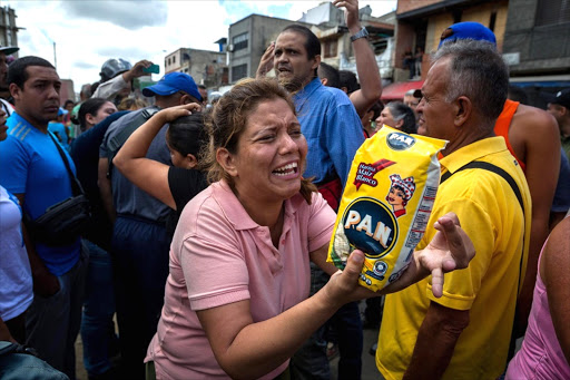 People protesting against the lack of food in parts of Caracas, Venezuela. Picture: EPA/MIGUEL GUTIERREZ