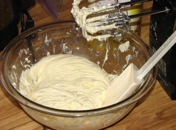 Blend softened cream cheese with sugar with beater til smooth.Mix in fruit cocktail.Fold in...