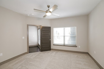 A3 bedroom with carpet and ceiling fan