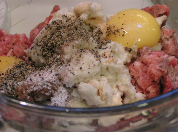 In the bowl of a stand mixer, combine the bread mixture, meats, seasonings and...