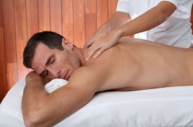 A man receiving a back massage