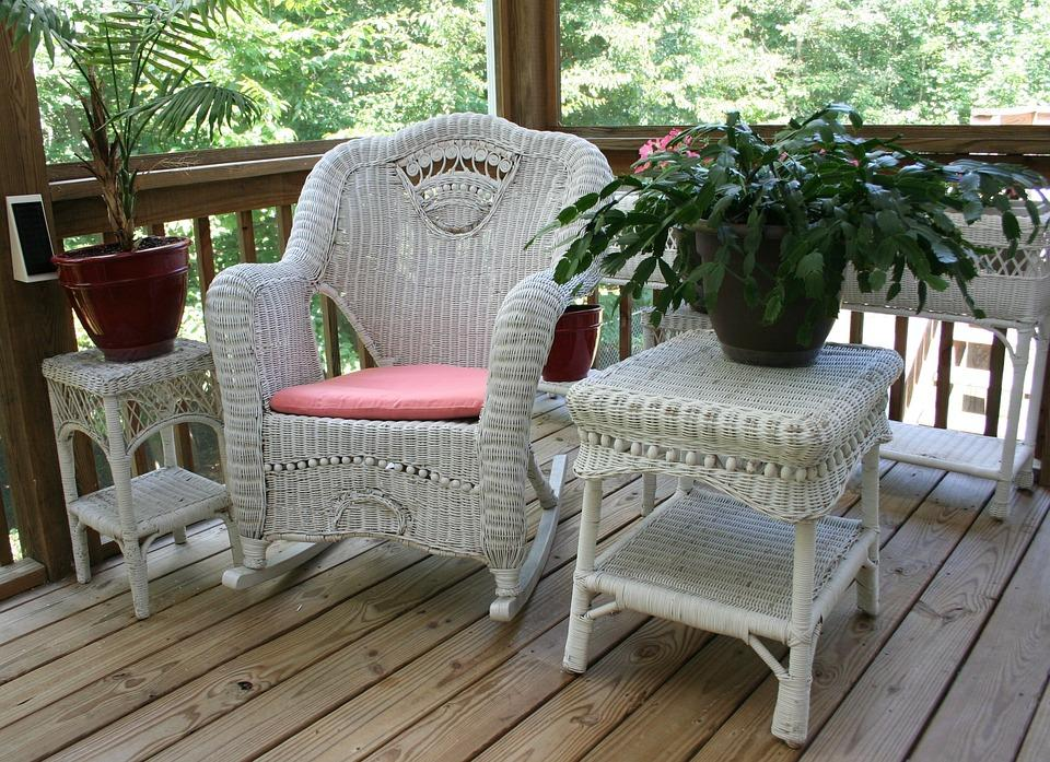 Wicker Rocking Chair on white porch