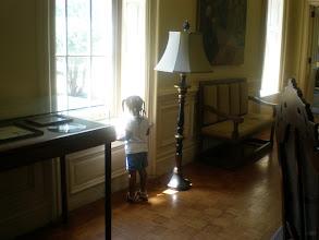 Photo: Kaleya looks out the window of Jubilee Hall.