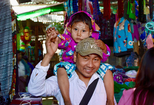 A father and son in a marketplace in the village of Myin Mu, Myanmar.