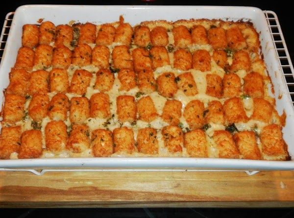 Put frozen tater tots in rows across  the top of the mixture,  and bake,...