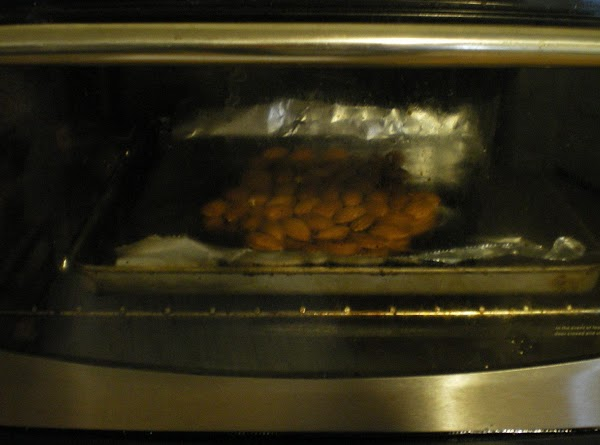 Toast almonds until fragrant in a 300 degree oven about 5 minutes.