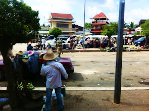 Photo: Ferry terminal across the Mekong River.  Vehicle waiting area full of food vendors.
