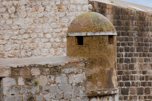 Old-Dubrovnik-medieval-turret.jpg - A medieval-era turret shows signs of its age atop the fortifications of Old Dubrovnik.