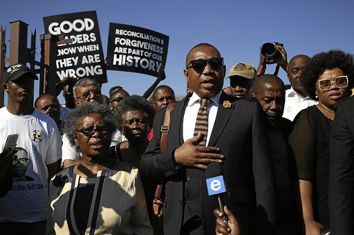HAND ON HEART Supporters of former deputy minister of higher education Mduduzi Manana, and women's rights activists, demonstrate outside Randburg Magistrate's Court, where Manana pleaded guilty to the assault charges against him Picture:  Alon Skuy