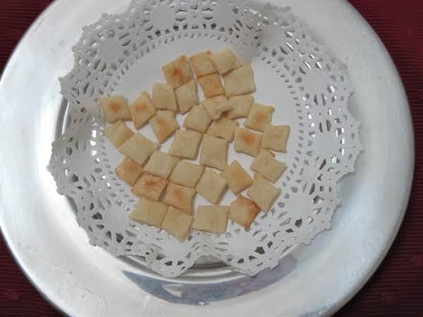 Communion Bread In Silver Plate.
