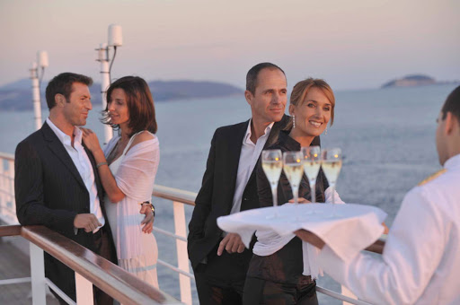 Sip fine Champagne on deck with fellow shipmates as you leave port on deck on your Ponant cruise.