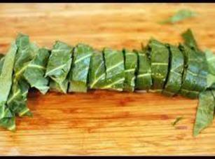 Start cutting from the bottom of the rolled stack of Collards about an inch...