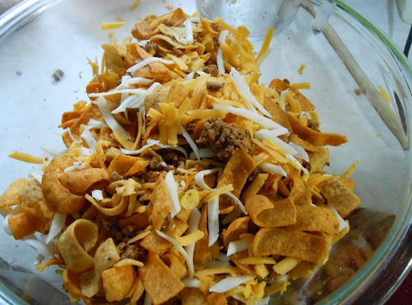 I poured the Fritos into a large bowl, added the cooked ground beef and...