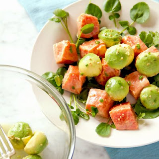 Marinated Wild Alaskan Salmon and Avocado Salad with Watercress.