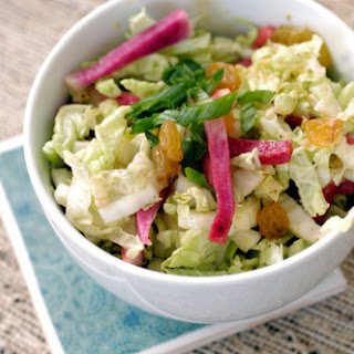 Shredded napa cabbage salad with radishes, golden raisins and Dijon dressing.