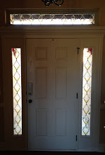 Photo: Replaced clear glass with stained glass thermopane units. Allows for beauty and privacy. Custom handmade beautiful front door, transom and doorway.