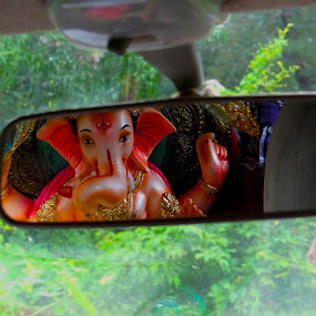Ganpati  by Abhishek Mestry - Buildings & Architecture Statues & Monuments ( car, mirror, reflection, village, ganpati, idol )