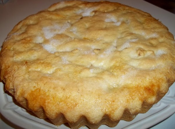 Brush the top with egg, and sprinkle with 1 - 2 tablespoons of sugar....