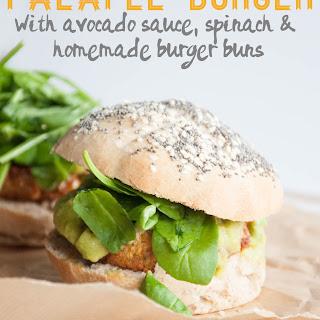 Vegan Falafel Burger with avocado sauce, spinach & homemade burger buns.