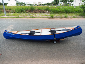 Photo: spent Saturday to make this simplest boat-moving trailer, some wooden planks and 2 small wheels
