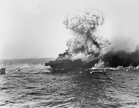 Photo: June 1942: The USS Lexington, U.S. Navy aircraft carrier, explodes after being bombed by Japanese planes in the Battle of the Coral Sea in the South Pacific during World War II. (AP Photo)