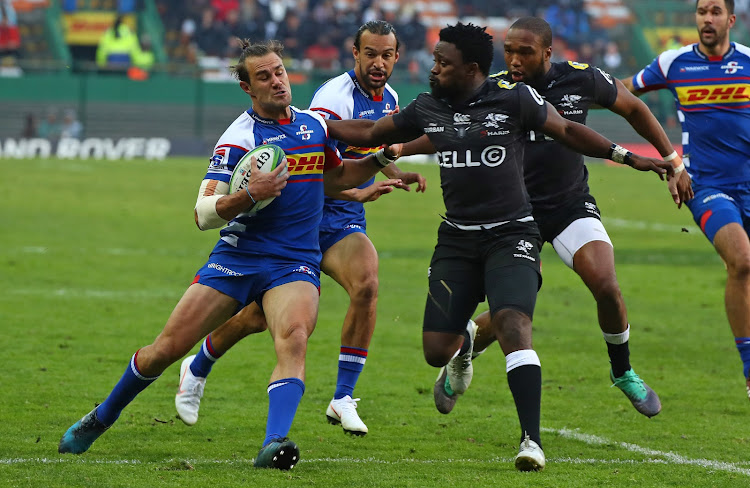 JJ Engelbrecht of the Stormers is tackled by Lwazi Mvovo of the Sharks during a Super Rugby match at Newlands Stadium, Cape Town on 7 July 2018.